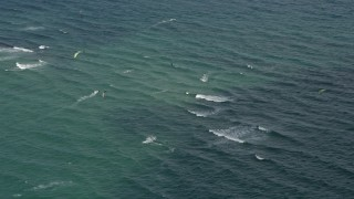 AX0031_166 - 5K stock footage aerial video of passing by kite surfers, Pompano Beach, Florida