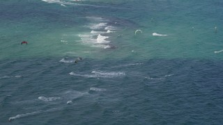AX0031_167 - 5K stock footage aerial video of flying by kite surfers, Pompano Beach, Florida