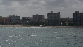 AX0031_168 - 5K stock footage aerial video of kite surfers in Pompano Beach, Florida