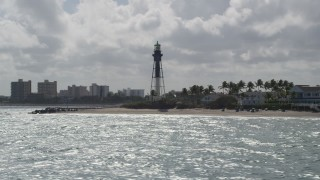 AX0031_172 - 5K stock footage aerial video of flying by the Hillsboro Inlet Light, Hillsboro Beach, Florida
