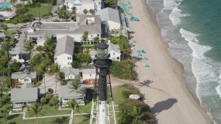 AX0031_174 - 5K stock footage aerial video of orbiting the Hillsboro Inlet Light, Hillsboro Beach, Florida