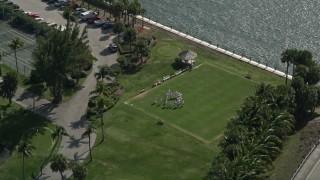 AX0031_175 - 5K stock footage aerial video of orbiting croquet players at Hillsboro Club, Hillsboro Beach, Florida
