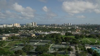 AX0032_001 - 5K stock footage aerial video fly over Pompano Community Park, approach condos, Pompano Beach, Florida