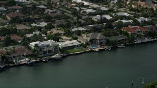 AX0032_010 - 5K stock footage aerial video of flying by mansions on the bank of Intracoastal Waterway, Lighthouse Point, Florida