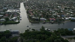 AX0032_012 - 5K stock footage aerial video fly by mansions, neighborhoods, Intracoastal Waterway, Lighthouse Point, Florida