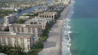 AX0032_013 - 5K stock footage aerial video of flying over the beach, revealing coastline, Hillsboro Beach, Florida