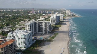 AX0032_019 - 5K stock footage aerial video of following beach, approaching inlet to Lake Boca Raton, Boca Raton, Florida