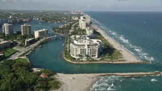 AX0032_020 - 5K stock footage aerial video approach condominium complex by inlet to Lake Boca Raton, Boca Raton, Florida