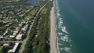 AX0032_025 - 5K stock footage aerial video of flying by the beach, South Beach Park, revealing coastline, Boca Raton, Florida