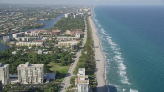 AX0032_028 - 5K stock footage aerial video of following the coast, North Ocean Boulevard, Boca Raton, Florida