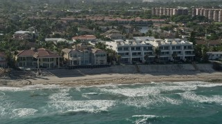 AX0032_034 - 5K stock footage aerial video flyby mansions, condominium complex on the beach, Highland Beach, Florida