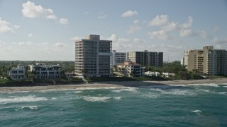 AX0032_037 - 5K stock footage aerial video flyby an apartment building by the beach, Highland Beach, Florida