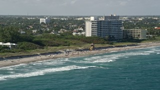 AX0032_041 - 5K stock footage aerial video flyby sunbathers on the beach, Delray Beach, Florida