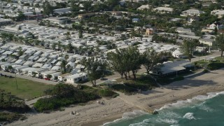 AX0032_049 - 5K stock footage aerial video of a mobile home park by the beach, Briny Breezes, Florida