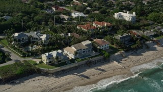 AX0032_051 - 5K stock footage aerial video flyby homes by the beach, Ocean Ridge, Florida