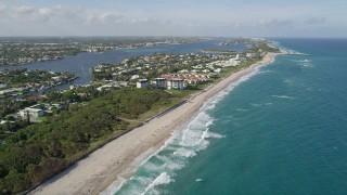 AX0032_053 - 5K stock footage aerial video follow coast by Boynton Beach Park, condominiums, Boynton Beach, Florida