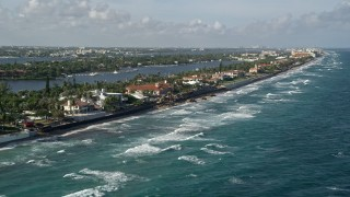 AX0032_058 - 5K stock footage aerial video of flying by coastal mansions, Manalapan, Florida