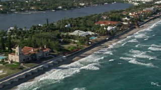 AX0032_059 - 5K stock footage aerial video of flying by a coastal mansion, Manalapan, Florida