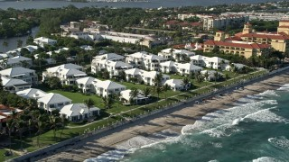 AX0032_060 - 5K stock footage aerial video of flying by beachside villas, Manalapan, Florida