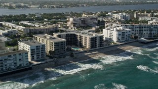 AX0032_061 - 5K stock footage aerial video of apartment building on the coast, Palm Beach, Florida