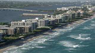 AX0032_063 - 5K stock footage aerial video of flying by coastal condominium complexes, Palm Beach, Florida