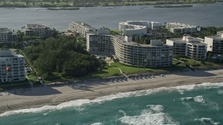 AX0032_065 - 5K stock footage aerial video of flying by a condominium complex on the coast, Palm Beach, Florida