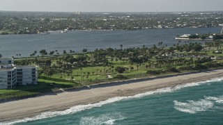 AX0032_066 - 5K stock footage aerial video of flying by the coastal Palm Beach Par-3 Golf Course, Palm Beach, Florida