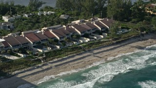 AX0032_069 - 5K stock footage aerial video of passing condominiums by the beach, Palm Beach, Florida