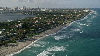 AX0032_075 - 5K stock footage aerial video of following the coast past upscale residential neighborhoods, Palm Beach, Florida