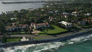 AX0032_077 - 5K stock footage aerial video of flying by coastal mansions, Palm Beach, Florida