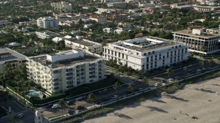 AX0032_078 - 5K stock footage aerial video of flying by coastal condominium complexes, Palm Beach, Florida