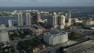 AX0032_087 - 5K stock footage aerial video of flying by Trump Plaza and apartment buildings, West Palm Beach, Florida