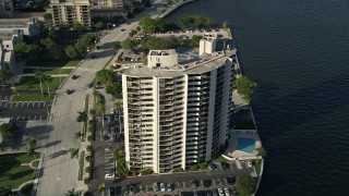 AX0032_091 - 5K stock footage aerial video of orbiting an apartment building, Intracoastal Waterway, West Palm Beach, Florida