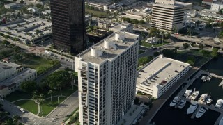 AX0032_094 - 5K stock footage aerial video of approaching an apartment building in West Palm Beach, Florida