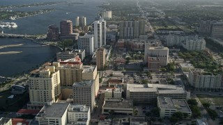 AX0032_095 - 5K stock footage aerial video of flying by office and apartment buildings, West Palm Beach, Florida