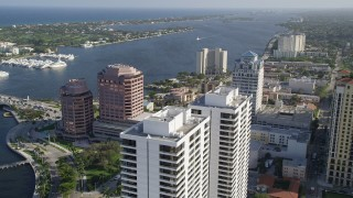 AX0032_097 - 5K stock footage aerial video of Trump Plaza, office buildings, Intracoastal Waterway, West Palm Beach, Florida