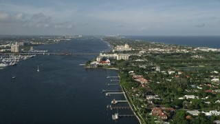 AX0032_100 - 5K stock footage aerial video of Flagler Memorial Bridge, Henry Morrison Flagler Museum, Palm Beach, Florida