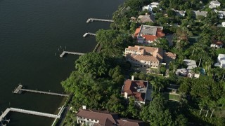 AX0032_101 - 5K stock footage aerial video of mansions, Intracoastal Waterway, Henry Morrison Flagler Museum, Palm Beach, Florida