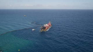 AX0032_110 - 5K stock footage aerial video of approaching a dredging ship near the coast, Palm Beach Shores, Florida