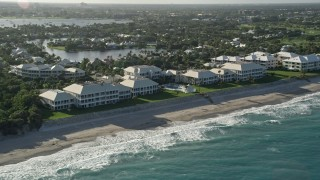 AX0032_123 - 5K stock footage aerial video of approaching coastal condominium complex, North Palm Beach, Florida