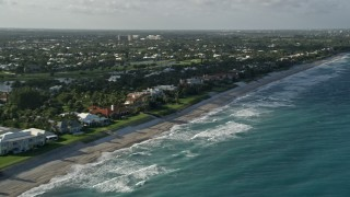 AX0032_124 - 5K stock footage aerial video of panning across homes by the beach on the coast, North Palm Beach, Florida