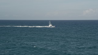 AX0032_137 - 5K stock footage aerial video of tracking a fishing boat cruising across the Atlantic, Jupiter, Florida