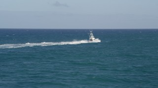 AX0032_138 - 5K stock footage aerial video of tracking a fishing boat sailing across the Atlantic, Jupiter, Florida
