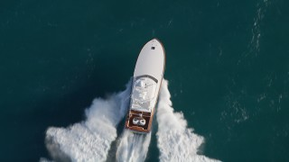 AX0032_142 - 5K stock footage aerial video of bird's eye view of a fishing boat sailing the Atlantic, Jupiter, Florida