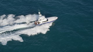 AX0032_143 - 5K stock footage aerial video of tracking a fishing boat sailing the Atlantic, Jupiter, Florida