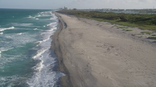 AX0032_146 - 5K stock footage aerial video of flying over beach, revealing sea birds, coast, Hobe Sound, Florida