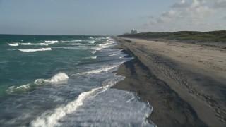 AX0032_146E - 5K stock footage aerial video of flying over beach, revealing sea birds, coast, Hobe Sound, Florida