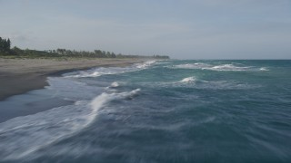 AX0032_150 - 5K stock footage aerial video of flying low over waves, veer right over the Atlantic, Hobe Sound, Florida
