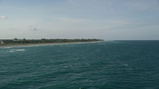 AX0032_151 - 5K stock footage aerial video of flying by the coast, Hobe Sound, Florida