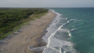AX0032_152 - 5K stock footage aerial video of flying low over the beach, Saint Lucie Inlet Preserve State Park, Stuart, Florida